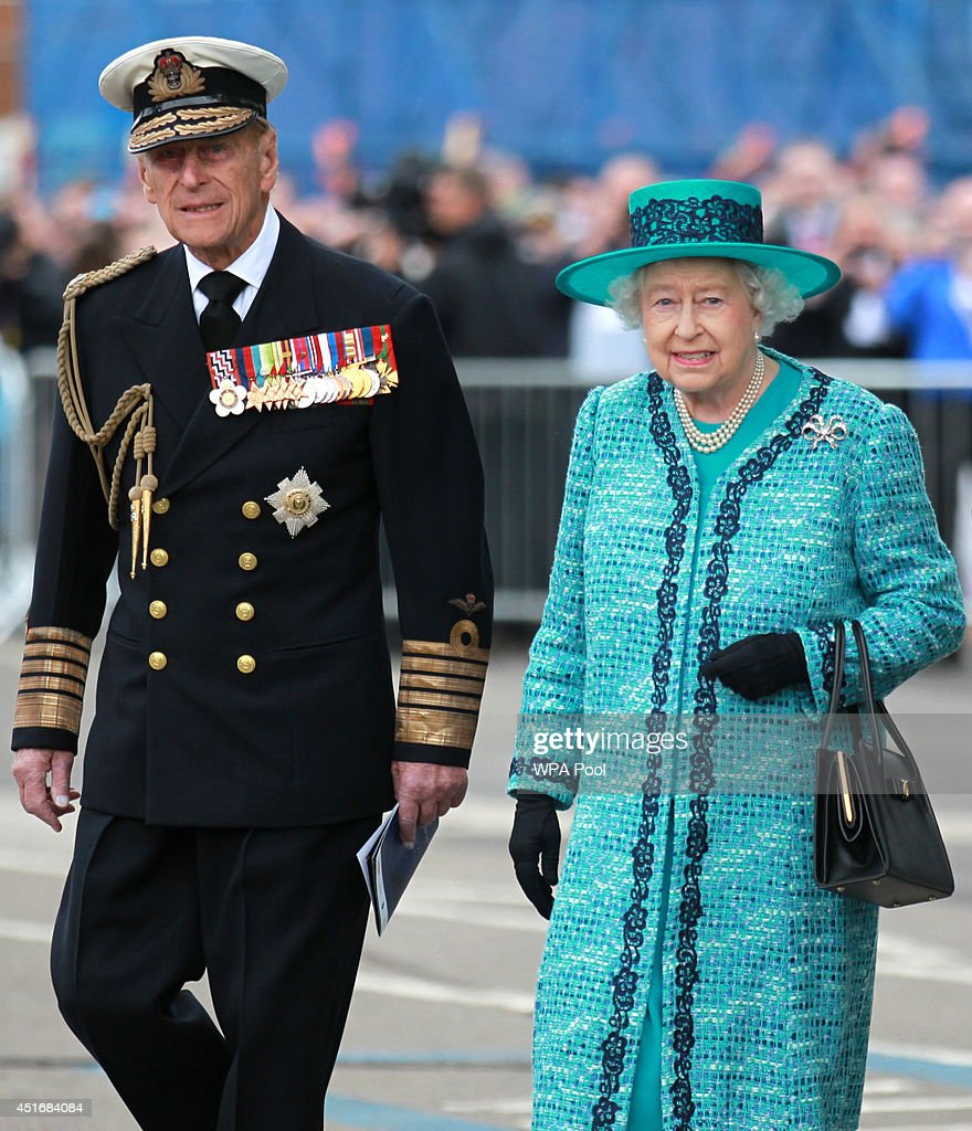 Queen <a gi-track='captionPersonalityLinkClicked' href=/galleries/search?phrase=Elizabeth+II&family=editorial&specificpeople=67226 ng-click='$event.stopPropagation()'>Elizabeth II</a> and <a gi-track='captionPersonalityLinkClicked' href=/galleries/search?phrase=Prince+Philip&family=editorial&specificpeople=92394 ng-click='$event.stopPropagation()'>Prince Philip</a>, Duke of Edinburgh at the formal naming ceremony for HMS Queen Elizabeth, the Royal Navy's biggest ever ship, on July 4, 2014 in Fife, Scotland. With whisky replacing the more traditional champagne at the ceremony, Queen <a gi-track='captionPersonalityLinkClicked' href=/galleries/search?phrase=Elizabeth+II&family=editorial&specificpeople=67226 ng-click='$event.stopPropagation()'>Elizabeth II</a> will smash a bottle of Islay malt whisky against the HMS Queen Elizabeth at the event at Rosyth Dockyard, where the 65,000-tonne aircraft carrier has been assembled and fitted out.