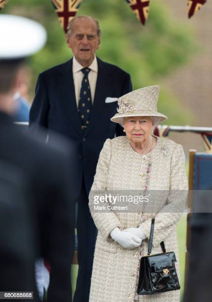 Queen Elizabeth II and Prince Philip Duke of Edinburgh attend a parade during a visit to Pangbourne College to celebrate it's centenary on May 9 2017...