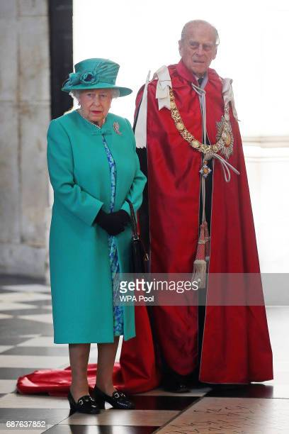 Queen Elizabeth II and Prince Philip Duke of Edinburgh attend a service at St Paul's Cathedral to mark the one hundredth anniversary of the Order of...