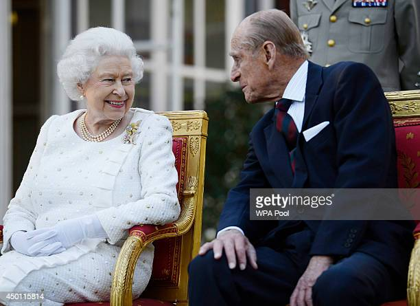 Queen Elizabeth II and Prince Philip Duke of Edinburgh attend a garden party in Paris hosted by Sir Peter Ricketts Britain's Ambassador to France...