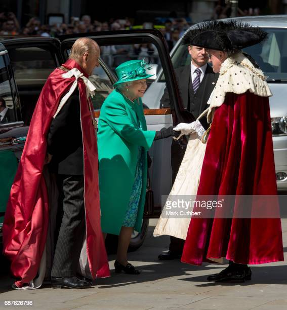 Queen Elizabeth II and Prince Philip Duke of Edinburgh attend a service to mark the one hundredth anniversary of the Order of the British Empire at...
