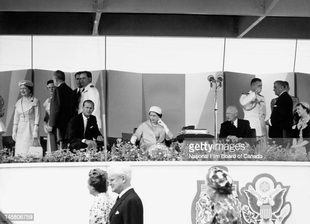 Queen Elizabeth II and Prince Philip Duke of Edinburgh attend in the company of US President Dwight D Eisenhower First Lady Mamie Eisenhower Canadian...