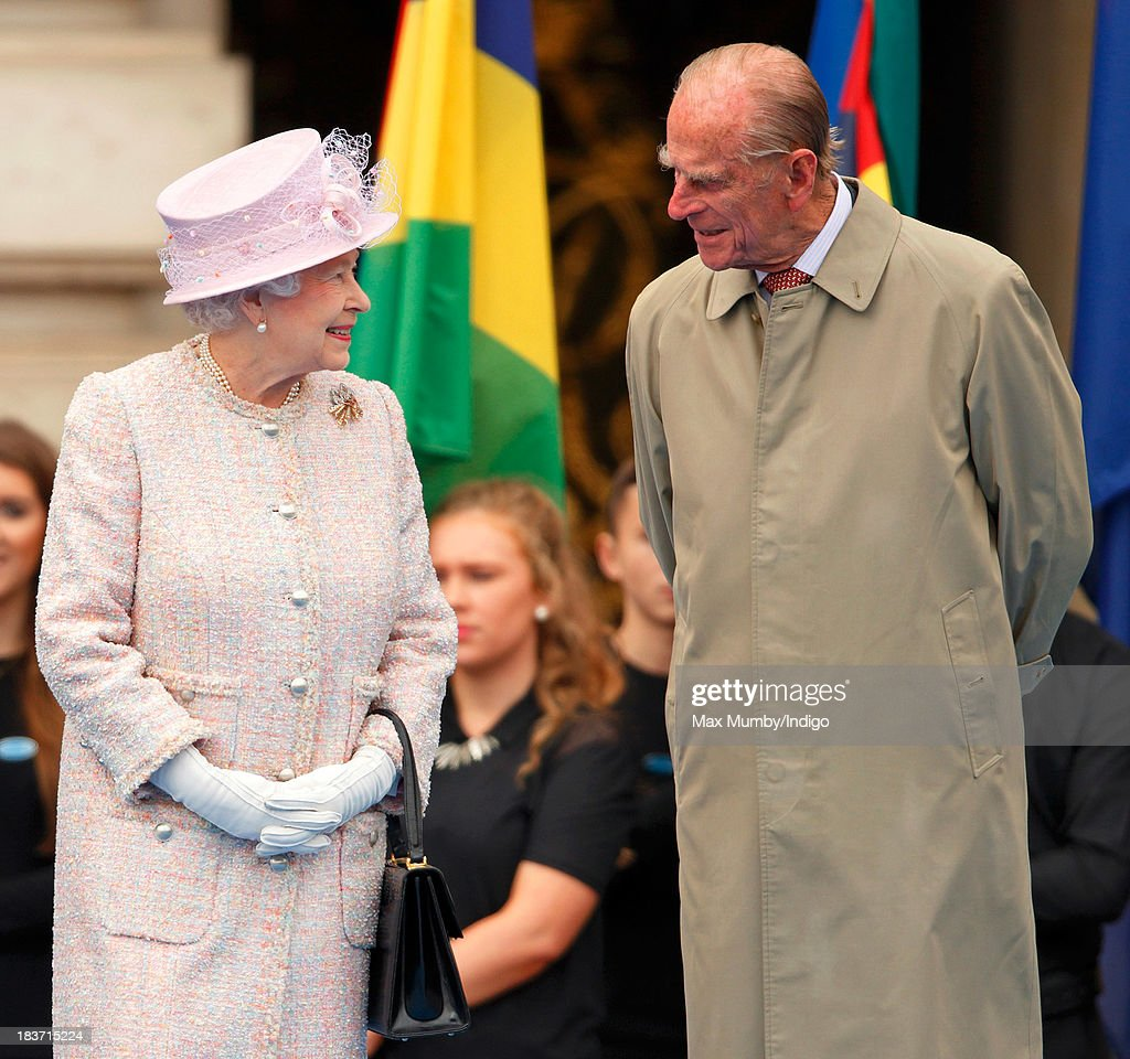 Queen <a gi-track='captionPersonalityLinkClicked' href=/galleries/search?phrase=Elizabeth+II&family=editorial&specificpeople=67226 ng-click='$event.stopPropagation()'>Elizabeth II</a> and <a gi-track='captionPersonalityLinkClicked' href=/galleries/search?phrase=Prince+Philip&family=editorial&specificpeople=92394 ng-click='$event.stopPropagation()'>Prince Philip</a>, Duke of Edinburgh attend the launch of the Queen's Baton Relay at Buckingham Palace on October 9, 2013 in London, England. Following the launch, the baton relay will continue it's journey visiting all 70 competing nations and territories ahead of the 2014 Glasgow Commonwealth Games.