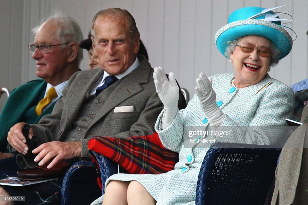 Queen Elizabeth II and Prince Philip, Duke of Edinburgh (C) attend the Braemar Highland Games at The Princess Royal and Duke of Fife Memorial Park on September 3, 2011 in Braemar, Scotland. The Braemar Gathering is the most famous of the Highland Games and is known worldwide. Each year thousands of visitors descend on this small Scottish village on the first Saturday in September to watch one of the more colorful Scottish traditions. The Gathering has a long history and in its modern form it stretches back nearly 200 years.