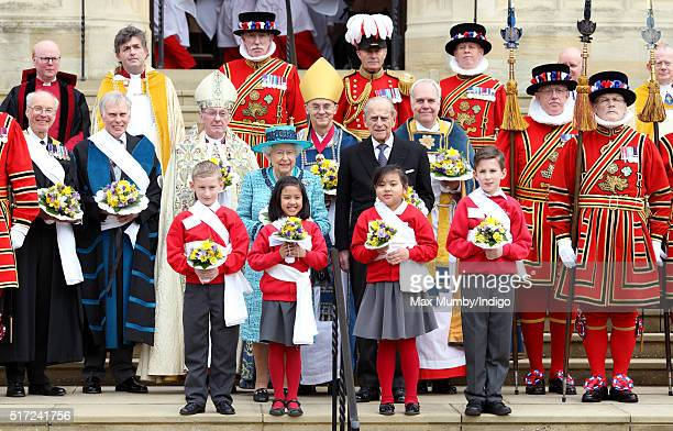 Queen Elizabeth II and Prince Philip Duke of Edinburgh attend the traditional Royal Maundy Service at St George's Chapel Windsor Castle on March 24...