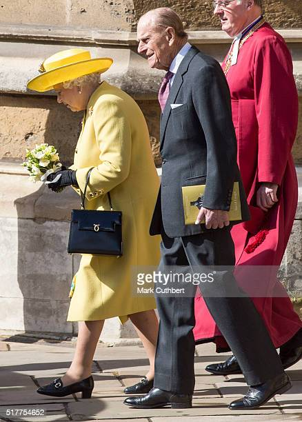 Queen Elizabeth II and Prince Philip Duke of Edinburgh attend the Easter Sunday Service at St George's Chapel on March 27 2016 in Windsor England