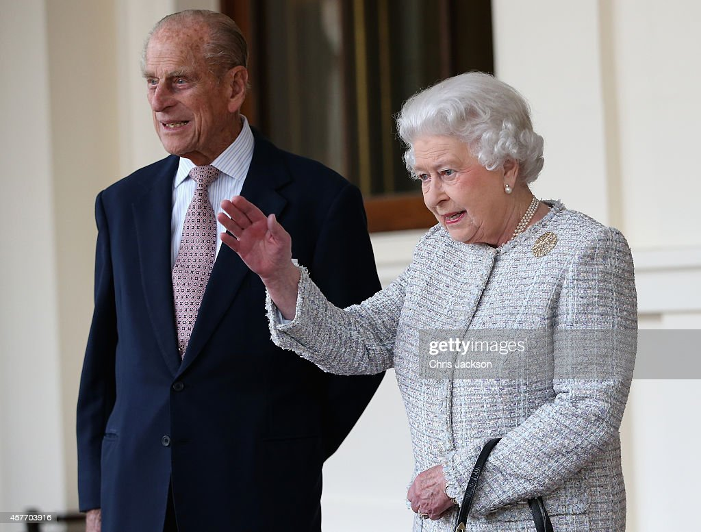 Queen Elizabeth II and Prince Philip, Duke of Edinburgh bid farewell to Singapore's President Tony Tan Keng Yam and his wife Mary at Buckingham Palace at the end of a State Visit on October 23, 2014 in London, England.