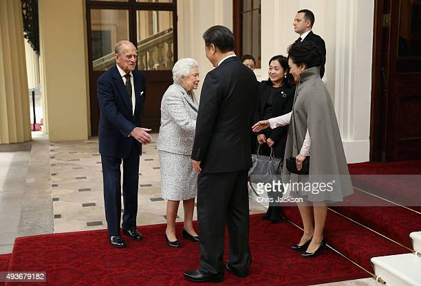 Queen Elizabeth II and Prince Philip Duke of Edinburgh bid farewell to President of the Peoples Republic of China Mr Xi Jinping and his wife Madame...
