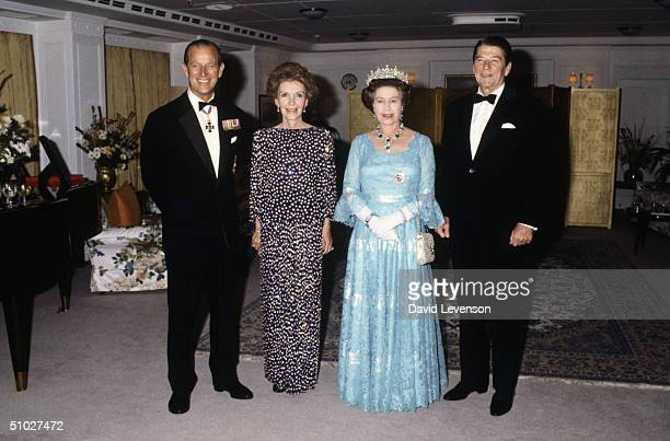 Queen Elizabeth II and Prince Philip Duke of Edinburgh entertaining President Ronald Reagan and Nancy Reagan on board HMY Britannia on March 4 1983...