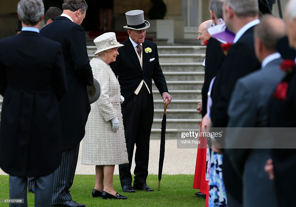 Queen Elizabeth II and Prince Philip, Duke of Edinburgh greet guests during a garden party in the grounds of Buckingham Palace on May 20, 2015 in London, England.