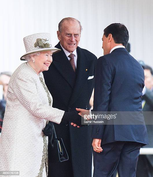 Queen Elizabeth II and Prince Philip Duke of Edinburgh greet Mexican President Enrique Pena Nieto during a ceremonial welcome for The President Of...