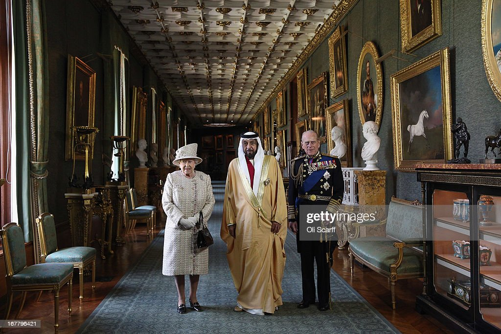 Queen <a gi-track='captionPersonalityLinkClicked' href=/galleries/search?phrase=Elizabeth+II&family=editorial&specificpeople=67226 ng-click='$event.stopPropagation()'>Elizabeth II</a> (L) and <a gi-track='captionPersonalityLinkClicked' href=/galleries/search?phrase=Prince+Philip&family=editorial&specificpeople=92394 ng-click='$event.stopPropagation()'>Prince Philip</a>, Duke of Edinburgh (R), greet The President of the United Arab Emirates, His Highness Sheikh Khalifa bin Zayed Al Nahyan (C), in Windsor Castle on April 30, 2013 in Windsor, England. The President of the United Arab Emirates is paying a two-day State Visit to the United Kingdom, staying in Windsor Castle as the guest of Her Majesty The Queen from April 30, 2013 to May 1, 2013. Sheikh Khalifa will meet the British Prime Minister David Cameron tomorrow at his Downing Street residence.