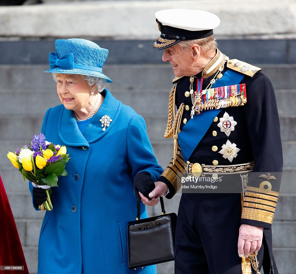 Queen Elizabeth II and Prince Philip, Duke of Edinburgh hold hands as they leave a Service of Commemoration to mark the end of combat operations in Afghanistan at St Paul's Cathedral on March 13, 2015 in London, England.