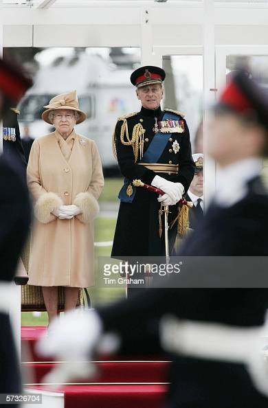 Queen Elizabeth II and Prince Philip Duke of Edinburgh inspect the Sovereign's Parade at Sandhurst Military Academy on April 12 2006 in Surrey England