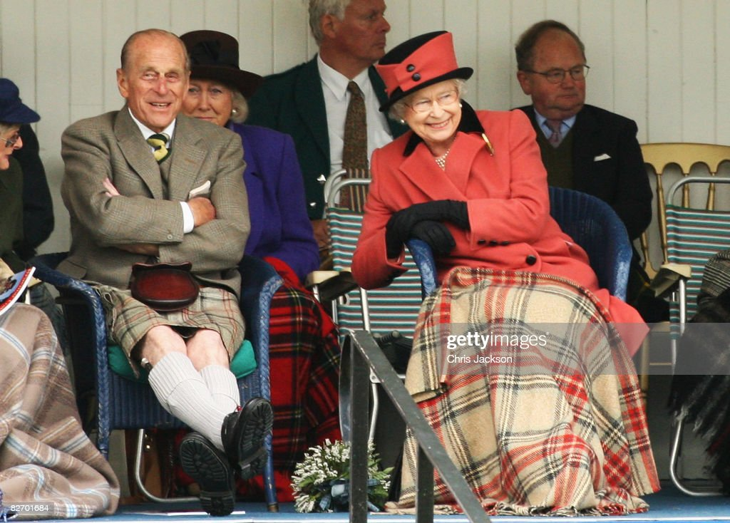Queen Elizabeth II and Prince Philip, Duke of Edinburgh laugh as they watch the games during the Annual Braemar Highland Gathering on September 6, 2008 in Braemar, Scotland. The Braemar Gathering is the most famous of the Highland Games and is known Worldwide. Each year thousands of visitors descend on this small Scottish village on the first Saturday in September to watch one of the more colourful Scottish traditions. The Gathering has a long history and in its modern form it stretches back nearly 200 years.