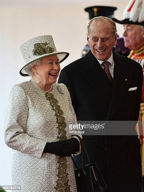 Queen Elizabeth II and Prince Philip Duke of Edinburgh laugh during a ceremonial welcome for the State Visit of The President of The United Mexican...