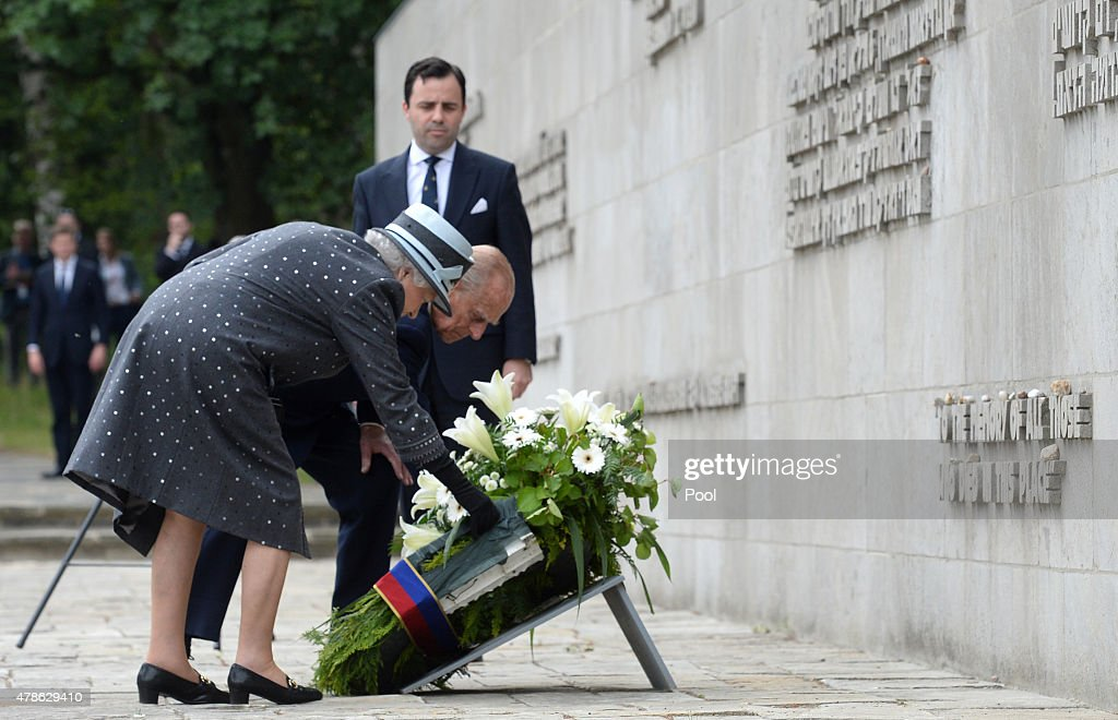 Queen Elizabeth II and Prince Philip, Duke of Edinburgh lay a wreath at the inscription wall during their visit of the concentration camp memorial at Bergen-Belsen on June 26, 2015 in Lohheide, Germany. The Queen and The Duke of Edinburgh viewed the grave of Anne Frank, before they met two survivors of the camp and as well as two liberators. This is the final day of a four day state visit, which is their first to Germany since 2004.