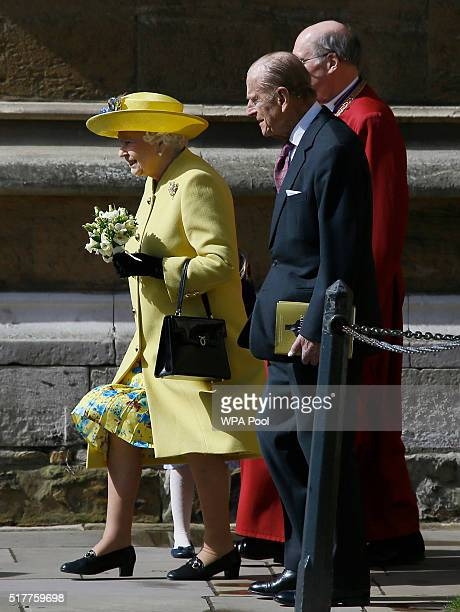 Queen Elizabeth II and Prince Philip Duke of Edinburgh leave after the Easter Sunday church service at St George's Chapel Windsor Castle on March 27...