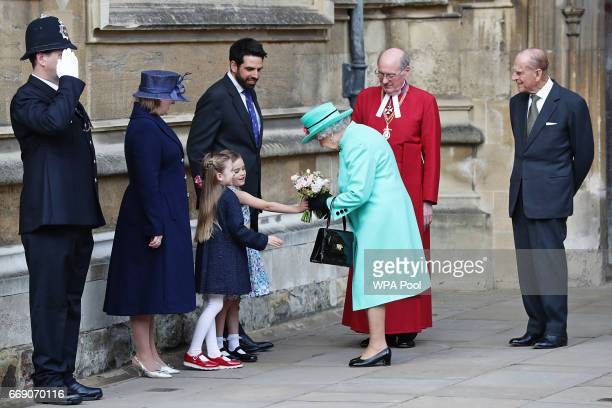 Queen Elizabeth II and Prince Philip Duke of Edinburgh leave after attending the Easter Sunday service at St George's Chapel at Windsor Castle on...