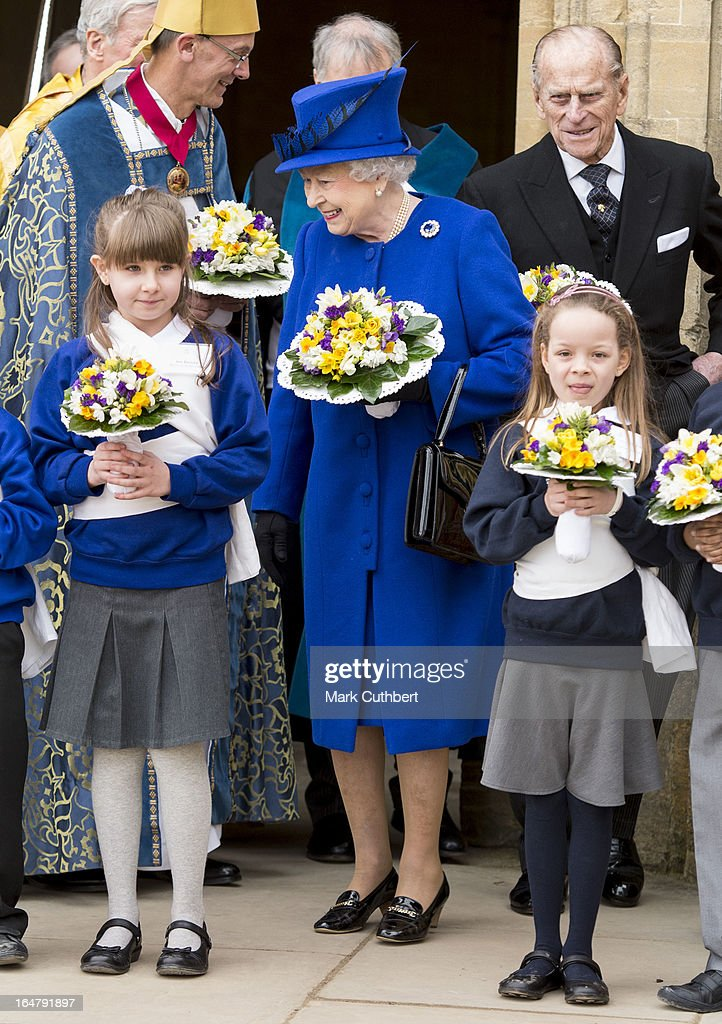 Queen Elizabeth II and Prince Philip, Duke of Edinburgh leaving Christs Church Cathedral in Oxford after The Royal Maundy Service on March 28, 2013 in Oxford, England.
