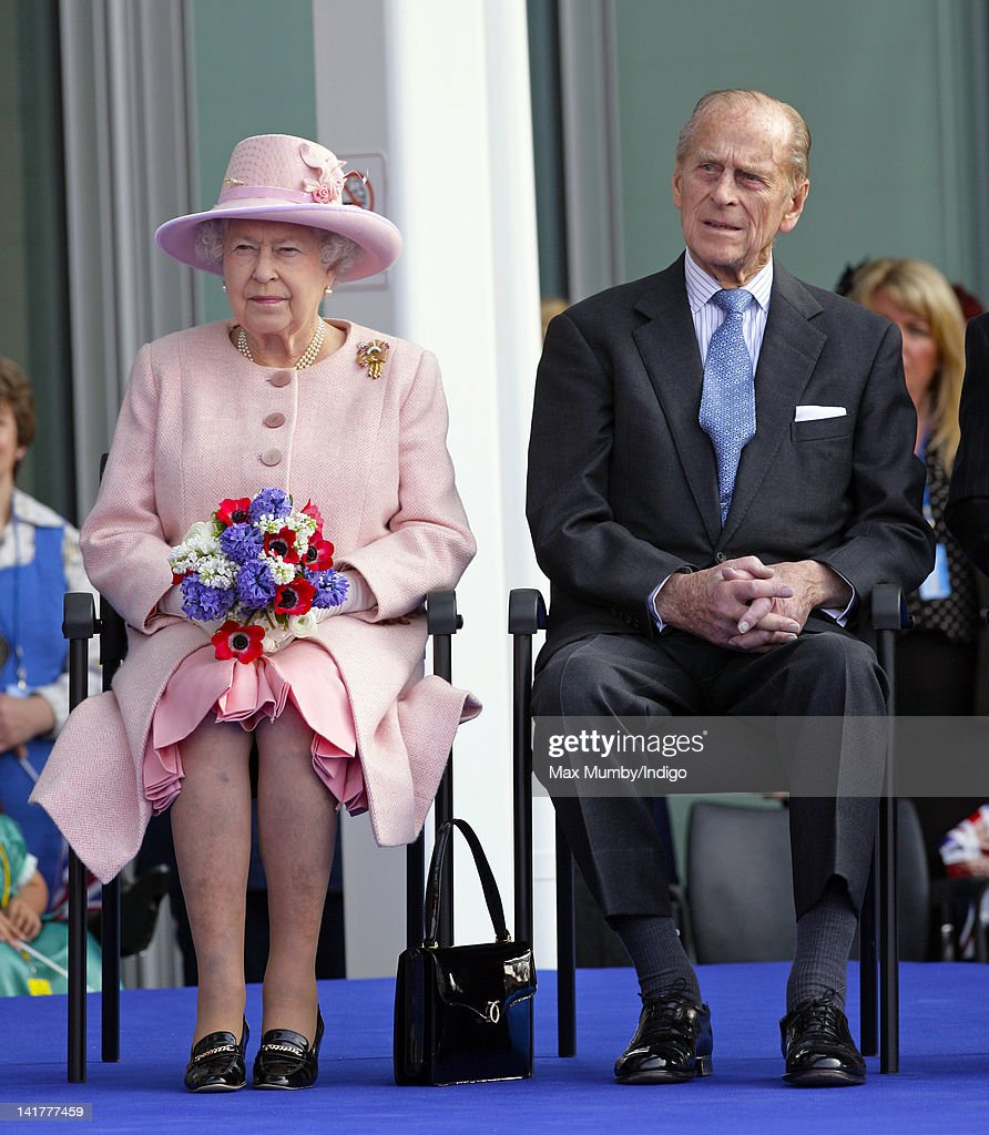 Queen <a gi-track='captionPersonalityLinkClicked' href=/galleries/search?phrase=Elizabeth+II&family=editorial&specificpeople=67226 ng-click='$event.stopPropagation()'>Elizabeth II</a> and <a gi-track='captionPersonalityLinkClicked' href=/galleries/search?phrase=Prince+Philip&family=editorial&specificpeople=92394 ng-click='$event.stopPropagation()'>Prince Philip</a>, Duke of Edinburgh listen to a speech as they visit St Mary's Hospital and the Manchester Royal Eye Hospital as part of Queen <a gi-track='captionPersonalityLinkClicked' href=/galleries/search?phrase=Elizabeth+II&family=editorial&specificpeople=67226 ng-click='$event.stopPropagation()'>Elizabeth II</a>'s Diamond Jubilee Tour of the UK on March 23, 2012 in Manchester, England.