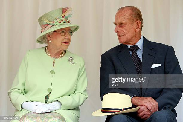 Queen Elizabeth II and Prince Philip Duke of Edinburgh look in before a Rainforest Walk at Southbank on October 24 2011 in Brisbane Australia The...