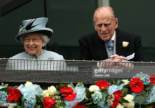 Queen Elizabeth II and Prince Philip Duke of Edinburgh look on during The Derby Festival at The Derby Festival at Epsom Racecourse on June 1 2013 in...