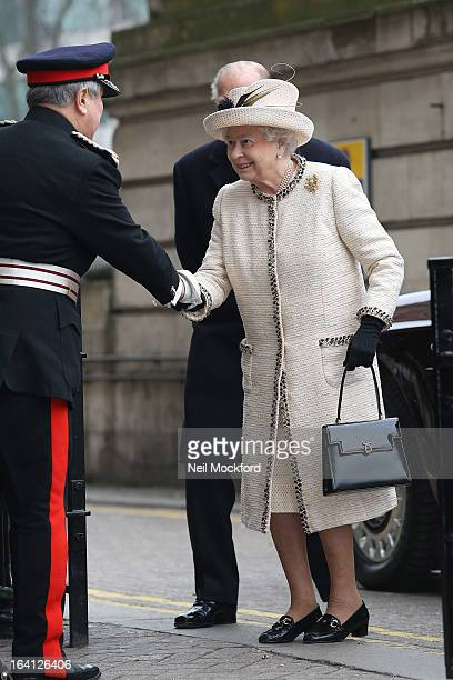 Queen Elizabeth II and Prince Philip Duke of Edinburgh make an official visit to Baker Street Underground Station on March 20 2013 in London England