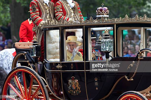 Queen Elizabeth II and Prince Philip Duke of Edinburgh make the journey by carriage in procession to Buckingham Palace following the wedding of...