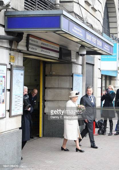 Queen Elizabeth II and Prince Philip Duke of Edinburgh makes an official visit to Baker Street Underground Station on March 20 2013 in London England