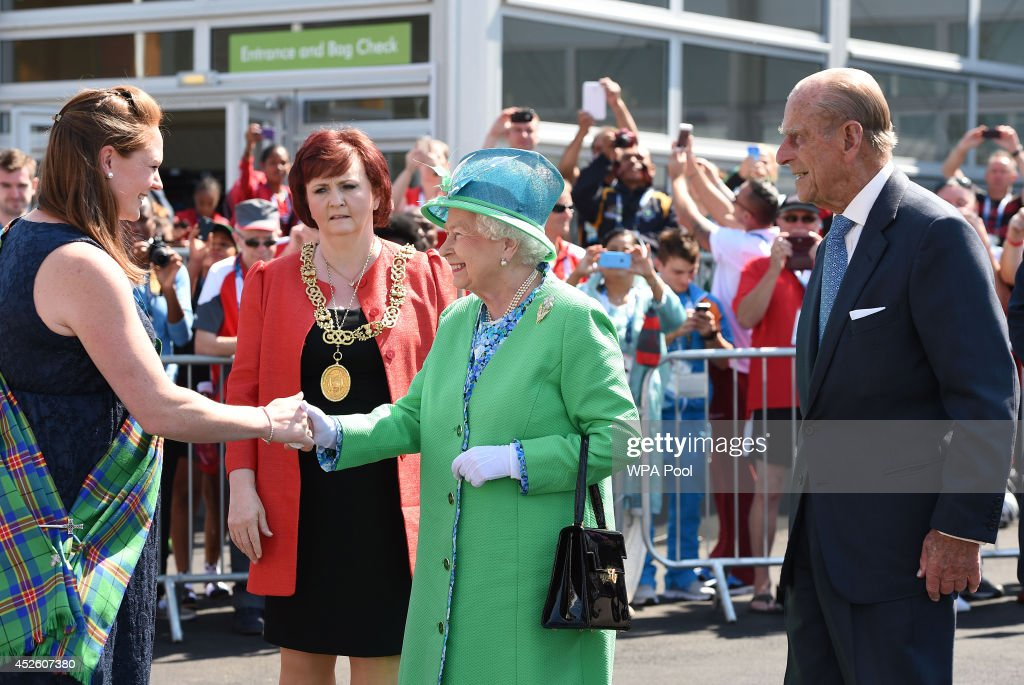 Queen Elizabeth II and Prince Philip, Duke of Edinburgh meet delegates and athletes on a visit to the Athlete's village during day one of the 20th Commonwealth Games on July 24, 2014 in Glasgow, Scotland.