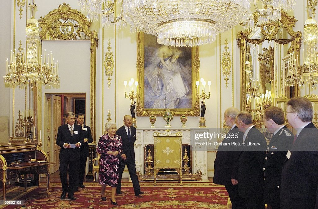 Queen Elizabeth II and Prince Philip, Duke of Edinburgh meet the Home Secretary Charles Clarke, the Mayor of London Ken Livingstone and the Metropolitan Police Commissioner Sir Ian Blair among others in the White Drawing Room inside Buckingham Palace on February 15, 2006 in London, England. Emergency response vehicles were gathered at the palace for an Emergency Services & Disaster Response Reception.