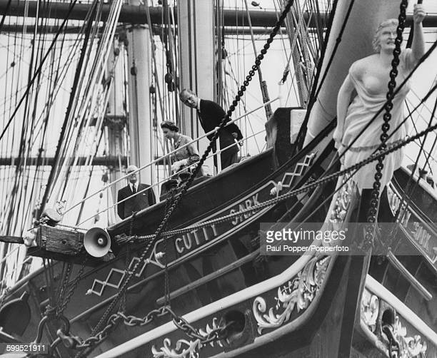 Queen Elizabeth II and Prince Philip Duke of Edinburgh pictured together on the deck of the 'Cutty Sark' sailing ship the last of the tea clippers at...