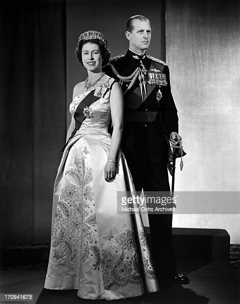 Queen Elizabeth II and Prince Philip Duke of Edinburgh pose for a portrait at home in Buckingham Palace in December 1958 in London England