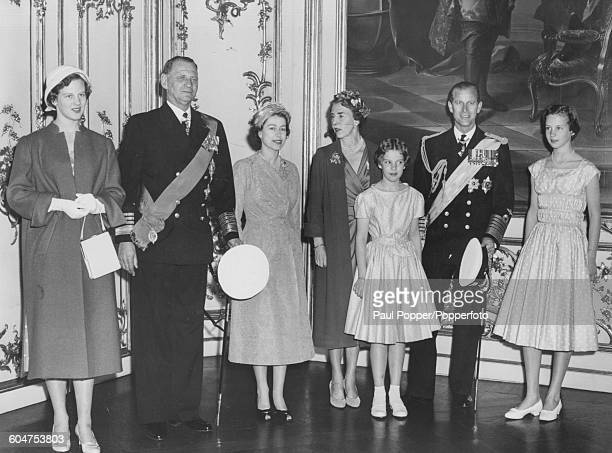 Queen Elizabeth II and Prince Philip Duke of Edinburgh pose for a portrait with the Danish Royal family Princess Margrethe King Frederick IX of...