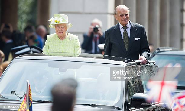 Queen Elizabeth II and Prince Philip Duke of Edinburgh ride in an open top vehicle around Windsor on her 90th Birthday on April 21 2016 in Windsor...