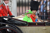 Queen Elizabeth II and Prince Philip Duke of Edinburgh sit in a carriage during the Trooping the Colour this year marking the Queen's 90th birthday...