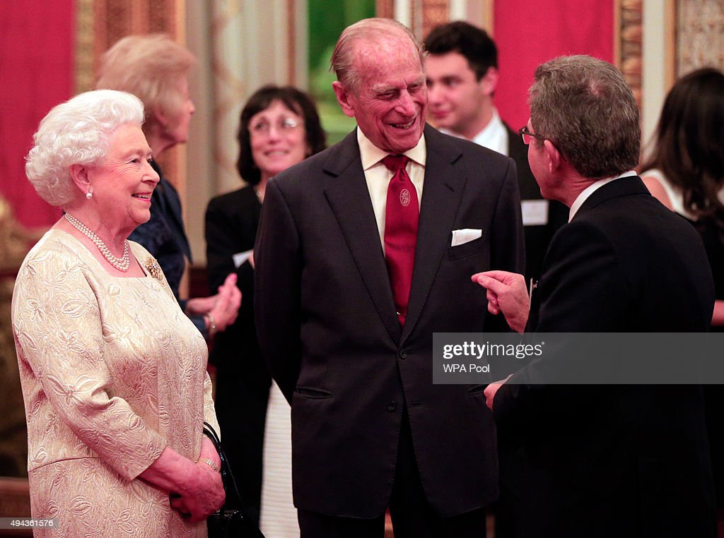 Queen Elizabeth II and Prince Philip, Duke of Edinburgh speak to guests during a reception for The Queen Elizabeth Prize for Engineering in the Throne Room at Buckingham Palace on October 26, 2015 in London, England. The Queen has presented a £1 million engineering prize to Dr Robert Langer at a reception at Buckingham Palace.