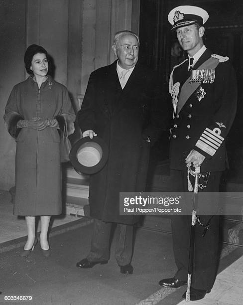Queen Elizabeth II and Prince Philip Duke of Edinburgh stand either side of Theodor Heuss President of the Federal Republic of Germany outside the...