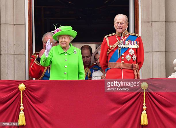Queen Elizabeth II and Prince Philip Duke of Edinburgh stand on the balcony during the Trooping the Colour this year marking the Queen's 90th...
