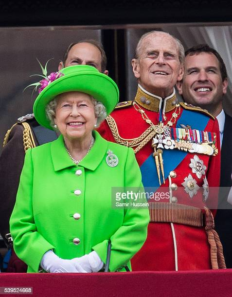 Queen Elizabeth II and Prince Philip Duke of Edinburgh stand on the balcony during the Trooping the Colour this year marking the Queen's official...