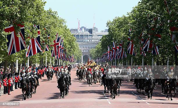 Queen Elizabeth II and Prince Philip Duke of Edinburgh travel down the Mall back to Buckingham Palace in the Diamond Jubilee State Coach after the...