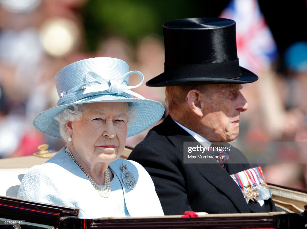 Queen Elizabeth II and Prince Philip, Duke of Edinburgh travel down The Mall in a horse drawn carriage during the annual Trooping the Colour Parade on June 17, 2017 in London, England. Trooping the Colour is a military parade to mark Queen Elizabeth II's official birthday and dates back to the time of Charles II in the 17th Century when the Colours of a Regiment were used as a rallying point in battle.