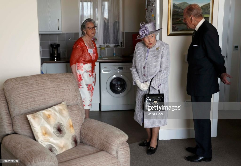 Queen Elizabeth II and Prince Philip, Duke of Edinburgh view a flat belonging to Pauline Stainsby (L) during a visit to Priory View, an independent living scheme for older residents on April 11, 2017 in Dunstable, United Kingdom.
