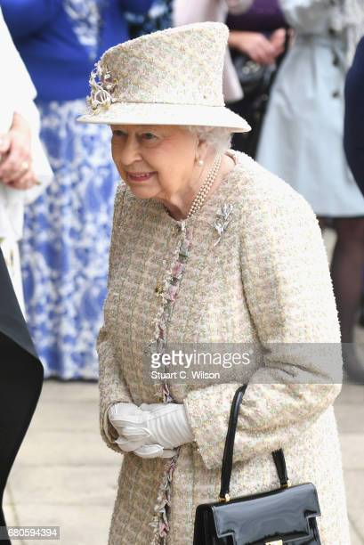 Queen Elizabeth II and Prince Philip Duke of Edinburgh visit Pangbourne College on the occasion of the school's centenary on May 9 2017 in Pangbourne...