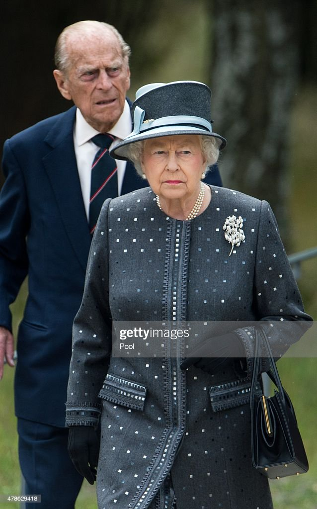 Queen Elizabeth II and Prince Philip, Duke of Edinburgh visit the concentration camp memorial at Bergen-Belsen on June 26, 2015 in Lohheide, Germany. The Queen and The Duke of Edinburgh viewed the grave of Anne Frank and laid a wreath at the inscription wall, before they met two survivors of the camp and as well as two liberators. This is the final day of a four day state visit, which is their first to Germany since 2004.
