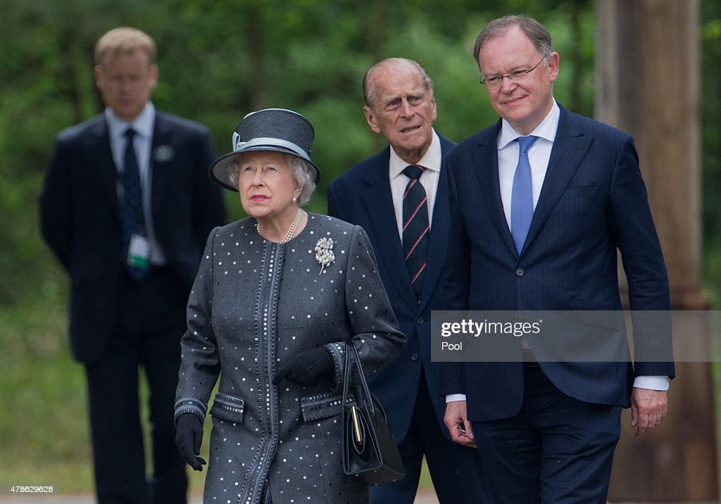Queen <a gi-track='captionPersonalityLinkClicked' href=/galleries/search?phrase=Elizabeth+II&family=editorial&specificpeople=67226 ng-click='$event.stopPropagation()'>Elizabeth II</a> and Prince Philip, Duke of Edinburgh visit with Prime Minister of the state of Lower Saxony <a gi-track='captionPersonalityLinkClicked' href=/galleries/search?phrase=Stephan+Weil&family=editorial&specificpeople=4683319 ng-click='$event.stopPropagation()'>Stephan Weil</a> (R) the concentration camp memorial at Bergen-Belsen on June 26, 2015 in Lohheide, Germany. The Queen and The Duke of Edinburgh viewed the grave of Anne Frank and laid a wreath at the inscription wall, before they met two survivors of the camp and as well as two liberators. This is the final day of a four day state visit, which is their first to Germany since 2004.