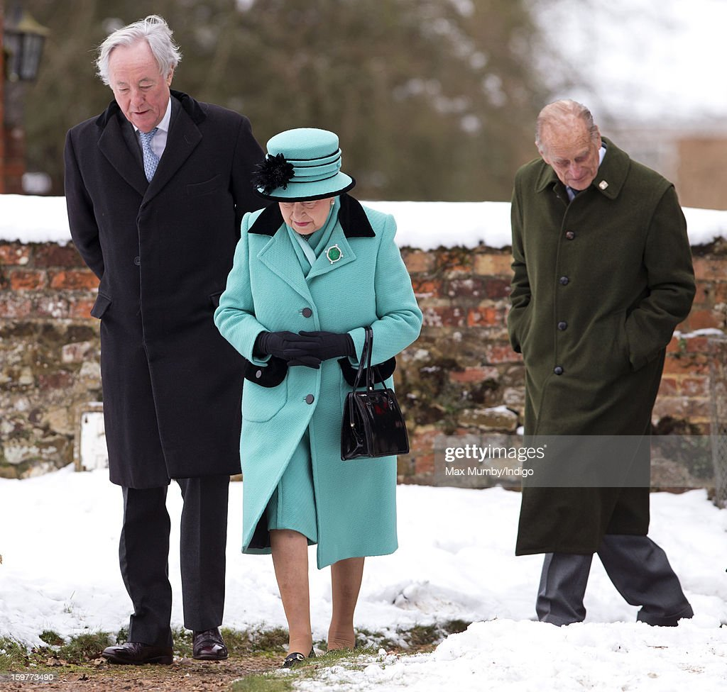 Queen Elizabeth II and Prince Philip, Duke of Edinburgh (R) walk through the snow covered church yard to attend Sunday Service at the Church of St Lawrence in Castle Rising near the Sandringham Estate on January 20, 2013 near King's Lynn, England.
