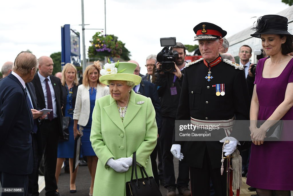 Queen Elizabeth II and Prince Philip, Duke Of Edinburgh walk with Secretary of state for Northern ireland Theresa Villiers (R) as they arrive on a steam train to open the new Bellarena Station village on June 28, 2016 in Bellarena, Northern Ireland.