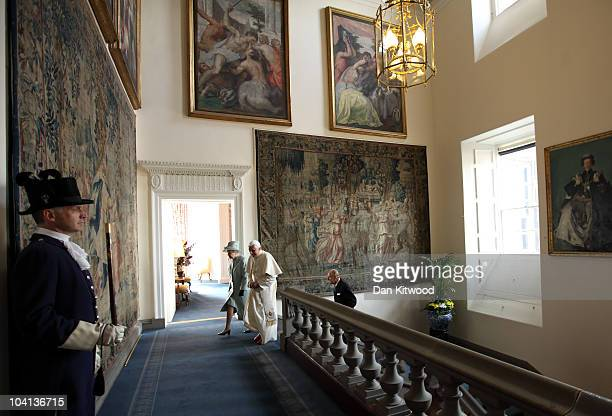 Queen Elizabeth II and Prince Philip Duke of Edinburgh walk with Pope Benedict XVI to the Morning Drawing Room in the Palace of Holyroodhouse the...